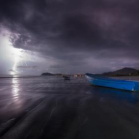 lightning hitting at sea shore