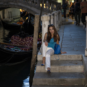 Girl walking in Venice in evening